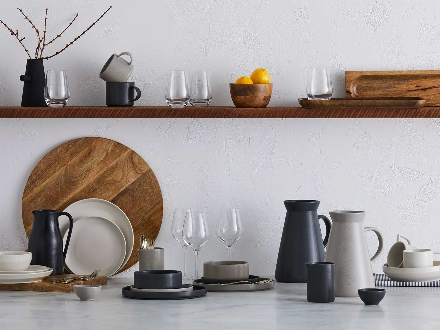 GlucksteinHome | Portuguese stoneware meets rich tones and striking silhouettes for a relaxed table to linger over